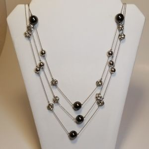 Express triple strand bead necklace